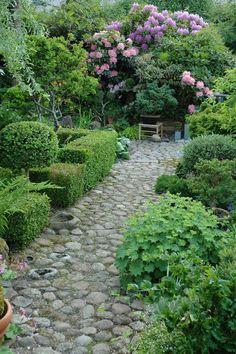 Beautiful stone pathway through the garden