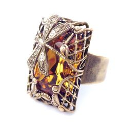Etsy listing at http://www.etsy.com/listing/150392735/adjustable-dragonfly-ring-in-amber-brass $75