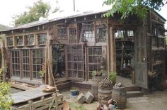 Greenhouse, potting shed from salvaged windows? Old Window Greenhouse, Best Greenhouse, Greenhouse Plans, Greenhouse Gardening, Greenhouse Wedding, Pallet Greenhouse, Homemade Greenhouse, Outdoor Greenhouse, Old Windows