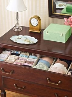 Organizing your underwear drawer: First edit out tattered, ill-fitting, or uncomfortable items. Use inexpensive drawer dividers to give everything a place (specially designed boxes for bras and cardboard organizers for underwear). Then, group undies by type (brief, bikini, thong). Fold bras one cup into the other, so cups keep their shape and take up less space.