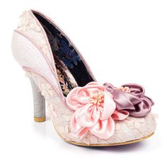 A fairytale floral princess dream, these dreamy high heels will put a spring in your step this season. Featuring a silver glitter heel and detail on the upper with a lace floral main upper and two beautiful silk flowers on the toe.