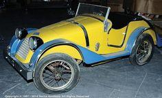"full size pedal car resembling a pre-war Riley pre-war open 2-seater sports car    battery powered, 54""/137cm  what fun!"