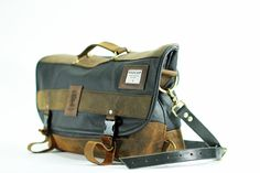Deluxe Laptop Messenger Bag. $345.00, via Etsy. Another bag to wish for... Beautiful handmade waxed canvas and leather!