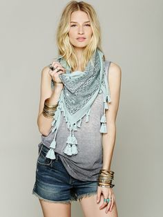 Free People Bandana Triangle Scarf can be worn on hips as a beach cover up, head wrap, or on a side table.