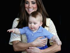 The Duchess of Cambridge holding Prince George at Taronga Zoo