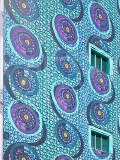 Yinka Shonibare art installation Wall 2010 Sceaux Gardens Camberwell London UK. Detail of patterned mural.