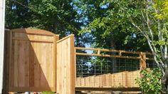 Hog panel fence with custom gate.