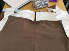 Step 23: sew with a cm seam allowance starting from the centre back and making sure to double back.