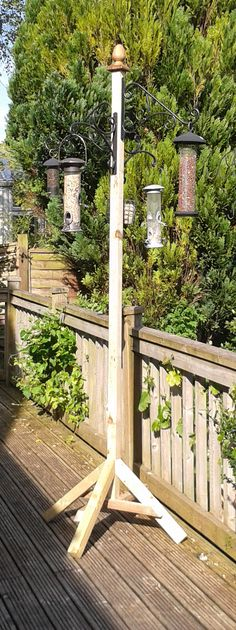 Bird feeding station - made using treated timber and wrought iron hanging basket hooks.