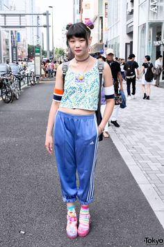 Elleanor is a friendly English-speaking #Harajuku girl who works at the popular Tokyo resale shop #Kinji . Her look features a colorful #odango #hairstyle w/ #Cassette #Playa x #JuJu #jelly #shoes & a resale crop top. More pics here. #tokyofashion #streetsnaps