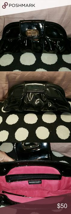"NWOT FRANCO SARTO LARGE BLACK CLUTCH NWOT FRANCO SARTO LARGE BLACK FAUX PATENT LEATHER CLUTCH. Fold over top piece with metal turn lock. HOT PINK LINING ?!!!! 2 INSIDE POCKETS, 1 ZIPPERED POCKET. Bag is 18""x7""x3""....the 3"" width expands to more....you can fit A TON OF STUFF IN THIS BAG!!! Franco Sarto Bags Clutches & Wristlets"