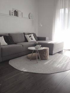 Coffee Table Teamed With The Wooden Stool And Big Floor Pillow Round Rug