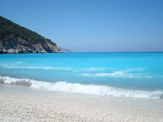 This is where I'd love to read all my books... Myrtos, Kefalonia, Greece - One of my favorite beaches!