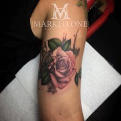 Girly bicep rose tattoo. Pink rose tattoo with leaves.