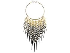 Made from over one hundred vintage Austrian crystals with spikes ranging from golden to black, this stunning necklace is a true head turner. Wear it over a button-up for an edgy conservative look.