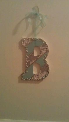 Michaels! Modge podg two pieces of scrapbook paper  and put any type of glitter around edges, add a bow and your done!
