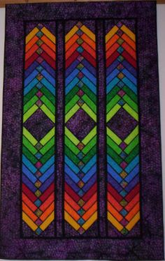 rainbow French Braid quilt by Eva Kilgore, posted at My Quilt Place