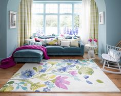 Bluebellgray Rug Tetbury Meadow Hand tufted luxury quality wool rugs with cascading watercolour blooms and foliage in a bright, fresh palette of pink, green, blue, yellow and soft amethyst purple on a creamy background.