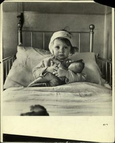 Three-year-old Eileen Dunne, a victim of the London Blitz, in hospital, 1940.