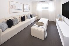 HOME THEATRE of Malibu 29 single storey home. On display at Housing World Wongawilli. Part of the Evolve range and brought to you by Masterton Homes Living Area, Living Spaces, Malibu Homes, Home Theater Rooms, Comfy Sofa, Storey Homes, New Home Builders, Love Home, Open Plan Living