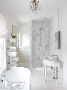 White marble bathroom. Pierce's palette confers a softness, a sense of quiet romance.