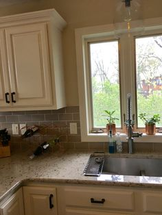 Cambria Windermere countertop, beige subway tile, divine white painted cupboards