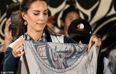 The blankets were printed with the outline of a grizzly bear, trees to represent the fores...