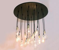 Circular Chandelier Uncovet .  How  easy would this be to duplicate!