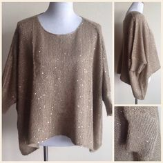 Clearance! Camel Star Dust Knit High Low Shrug This will be the first thing you want  to put on when you need something, comfy, chic and effortless. This is a camel &  gold stardust/sequined. Sweater/Shrug. It is OS and assymetrical. (Shorter in the front, longer on the sides) Amazing with jeans or Khaki's. Tops