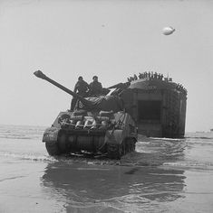 The British Army in Normandy. A Sherman Firefly coming ashore from an LST (Landing Ship Tank), Sword Beach, 7 June 1944