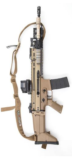 FN SCAR by (Photo Credit: Stickman) probably won't be able to own thanks to liberal nut jobs, as well as republican nut jobs who represent us