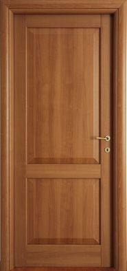 Modello 2B  in #legno listellare. Rivestimento esterno in Laminato. Colore: Noce Biondo. Linea Bugnata - Catalogo Motivo. #porte #classiche #belle