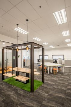 This swinging bench seating and table works with the green carpet to give your staff the feeling of being in a park environment. It makes for brililant casual and relaxed conversation space or somewhere to enjoy a bit of peace and quiet! Workspace Design, Office Workspace, Shop Interiors, Office Interiors, Creative Office, Office Pods, Office Carpet, Open Space Office, Warehouse Design