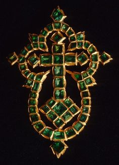 A gold cross of fine workmanship inset with 65 Colombian emeralds. Recovered from the wreck of Nuestra Señora de las Maravillas (ship) 1656