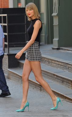 Shoe Candy from Taylor Swift's Street Style  Sure we love her head-to-toe ensemble, but its those turquoisePedro García'spatent leather pumps that steal the show.