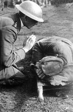 A British priest gives the last rights to a German soldier, World War I.