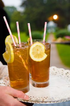 Signature wedding drinks don't have to be alcoholic.  Sweet lemonade tea with adorable straws. Photo by Fucci's Photos.