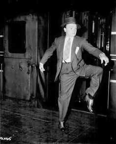 "James Cagney does a little dance upon arriving in NYC for the premiere of 'Yankee Doodle Dandy""."