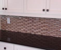 White and Brown kitchen  Brown color back splash
