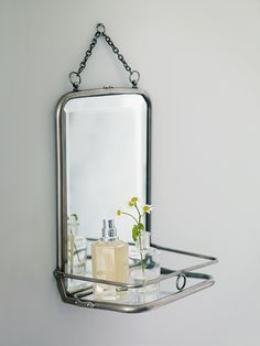 Feminine and French-style with delicate bevelled edging and a clever foldaway shelf, our French Folding Mirror can be easily hung from any wall.