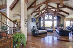 Living and entry space, wood beams, rustic floors