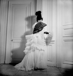 French fashion designer Coco Chanel (1883 - 1971) wearing an evening dress with bustle at a ball given by the Comte de Beaumont, Paris, circa 1935.
