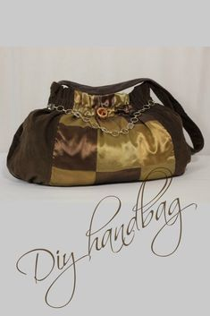 DIY Fabric Handbag with chain detail. The materials are pin-whale corduroy and polyester drapery fabric. The hardware used to be my belt.  #diyhandbag #fabrichandbag #summerhandbag