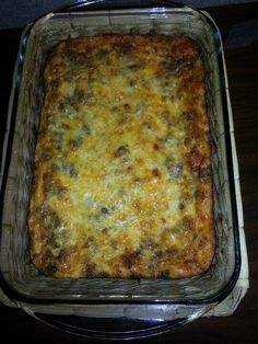 Breakfast casserole . . . Easy and cheap. Brown a roll of Jimmy Dean sausage and drain the grease. Tear up about 7 slices of bread and place them on a pam sprayed bottom of a 9x13 glass pan. Cover the bread with sausage and spread about 2 cups pf mixed shredded cheese on top of the sausage. Mix 10 eggs and a cup and a half of milk and pour it on top. Cover and let sit over night. Next morning cook at 350 for 45 min or until browned. Yummy!