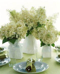 Arreglo floral con bolsas de papel