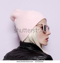 Pretty Lady in fashionable hat beanie and pink glasses Vanilla vibration Swag