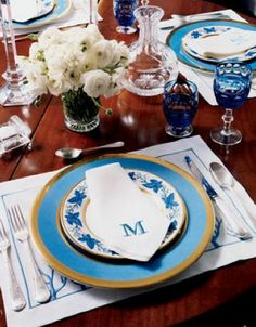 Bright aqua dinnerware, monogrammed napkins and gorgeous coloured crystal. Perfect.