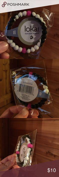 Authentic Black, White, and Pink Lokai Bracelet! Size: Medium. Never opened! Wonderful product! Authentic Lokai bracelet! Lokai Accessories