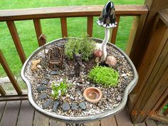 This is my Fairy Garden. It changes with the seasons and when I bring it into the house for the winter and some of the plants die down, I place potted violets on the gravel and it becomes beautiful for the winter! vctc