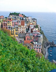 The Cinque Terre hiking trail in Italy offers picturesque views of the sea and villages from above, like this striking image of Manarola. Italy Vacation, Vacation Spots, The Places Youll Go, Places To Go, Places To Travel, Travel Destinations, Things To Do In Italy, Cinque Terre Italy, Seaside Village